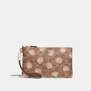 NWT Coach RARE rose print wristlet-PRICE FIRM
